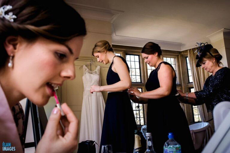 Bride getting ready before her wedding at Coombe Lodge