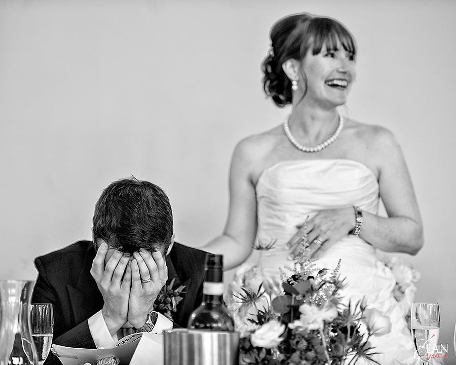 Thje Brides speech at Coombe Lodge Blagdon - the groom holding his head in his hands