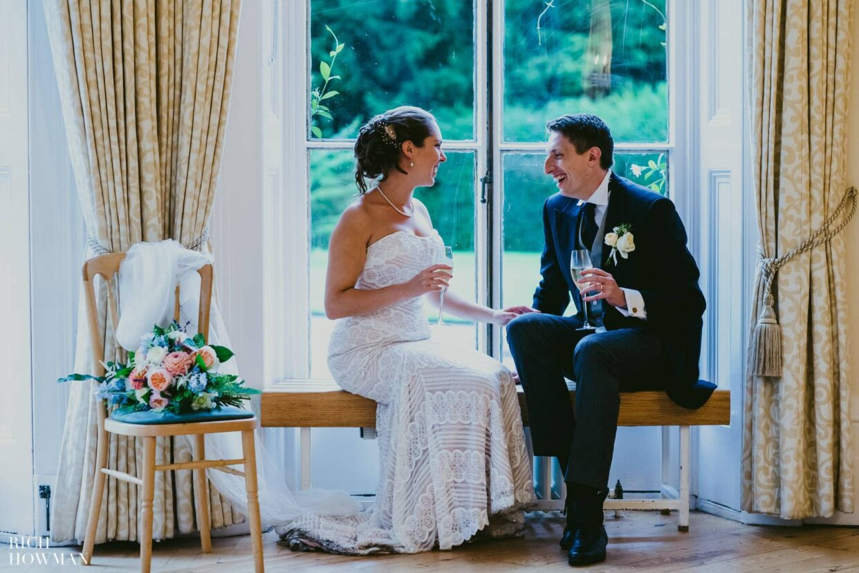 bride and groom relaxing with champagne at wedding at kew gardens