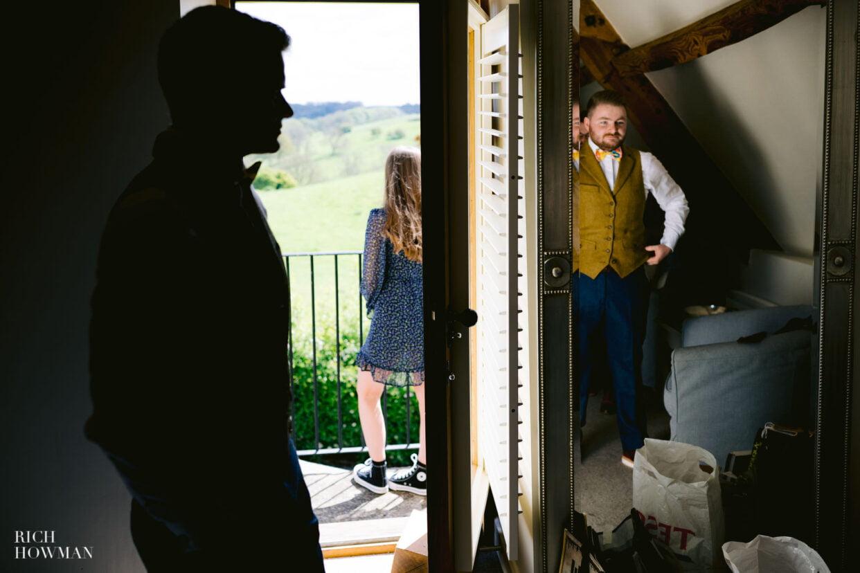 groom prepares for Gloucestershire barn wedding