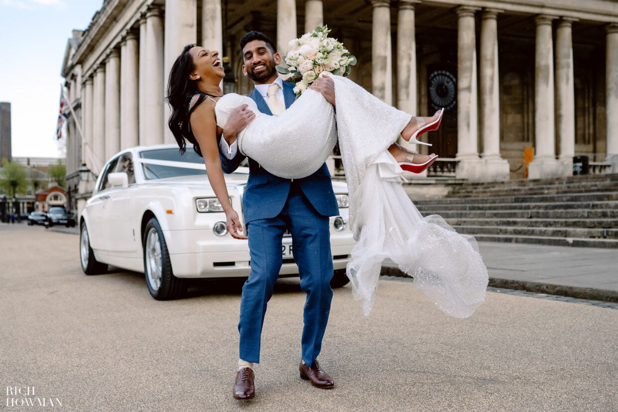 Groom carrying bride captured by old royal naval college wedding photographer