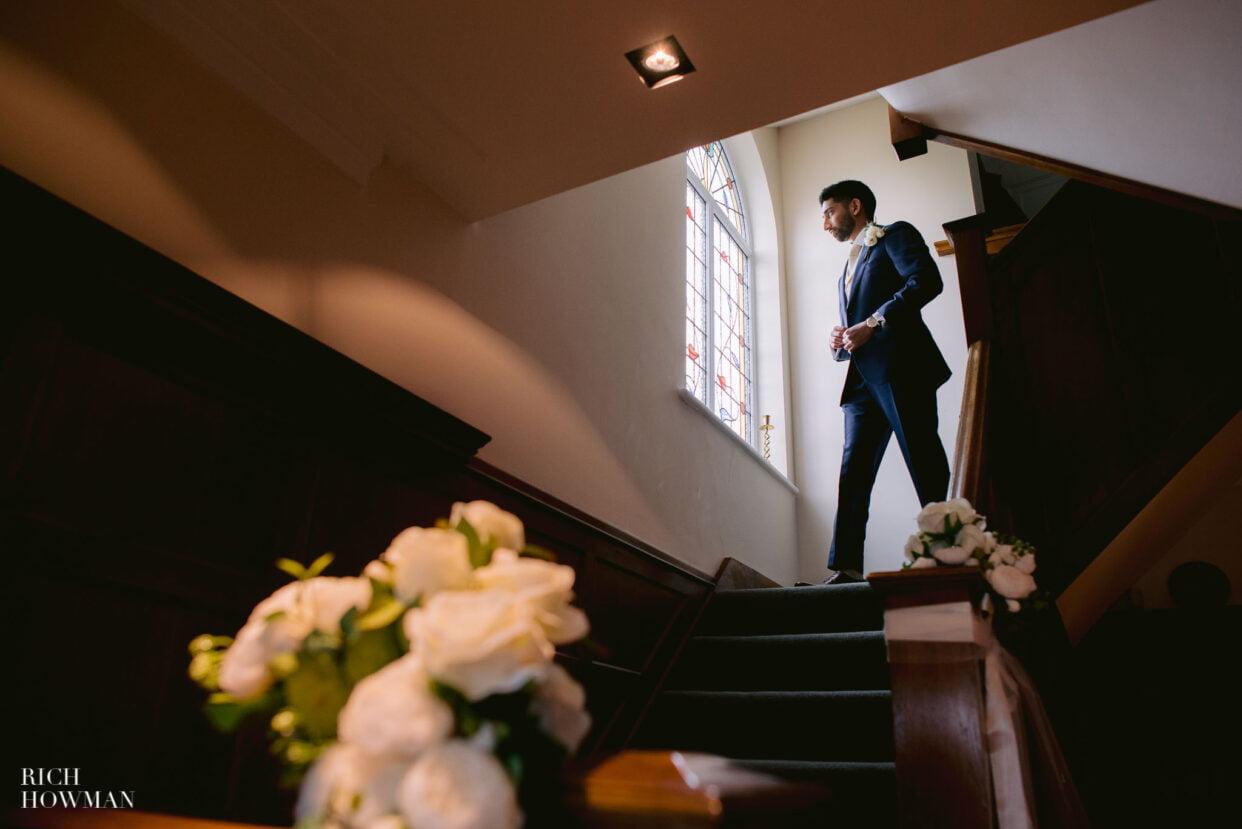 Groom preparing for old royal naval college wedding