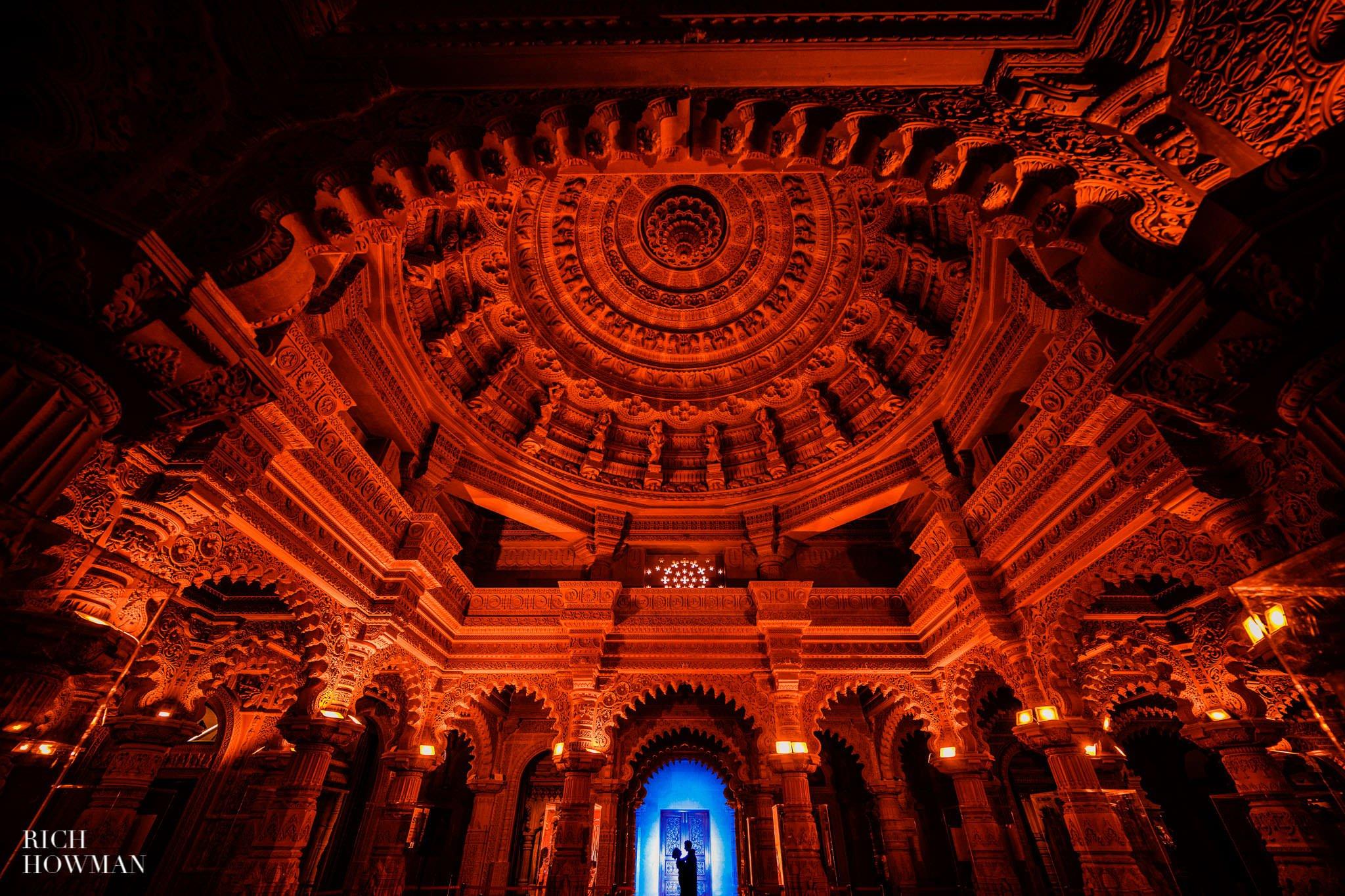 tamil hindu wedding photographer captures bride and groom temple portrait